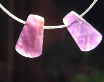 Amethsyt beads   .................. 2 pieces           15 X 9  x 4 mm  ....................................            4368