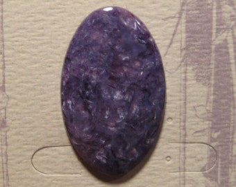 Beautiful Charoite Cab .............   41  x  25 x 4.7 mm thick ......    a4758