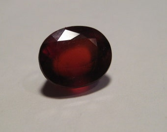 Faceted Hessonite Garnet gemstone ...   12 x 10 x 7 mm............     581