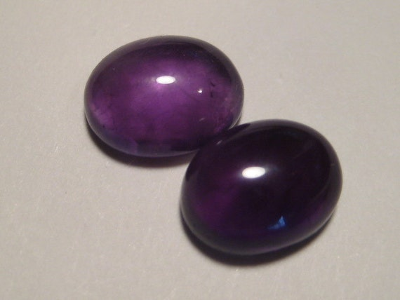 Amethyst cabs .....       2 pieces ............            10  x 8  x 4 mm .....                       607
