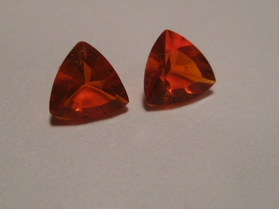 Mexican Opal faceted stone ........  5 mm x 3mm thick  ..... 2 pieces....... trilliant shape........   621