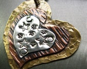 Riveted heart pendant in sterling silver, copper and brass
