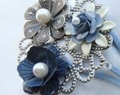 Light blue, Navy blue, and silver flower bed, suede wrap bracelet