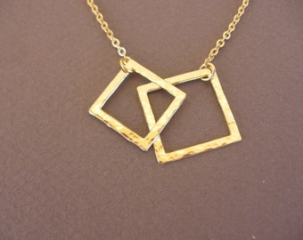 hammered  gold connected squares. gold necklace .together ,classic every day necklace. only 19 dollars