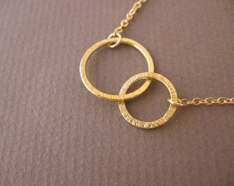 Brushed   2   gold hoops necklace.Infinity pendant