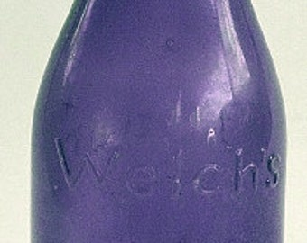 Small antique WELCH'S Jr. GRAPE JUICE bottle in a vibrant deep purple amethyst color
