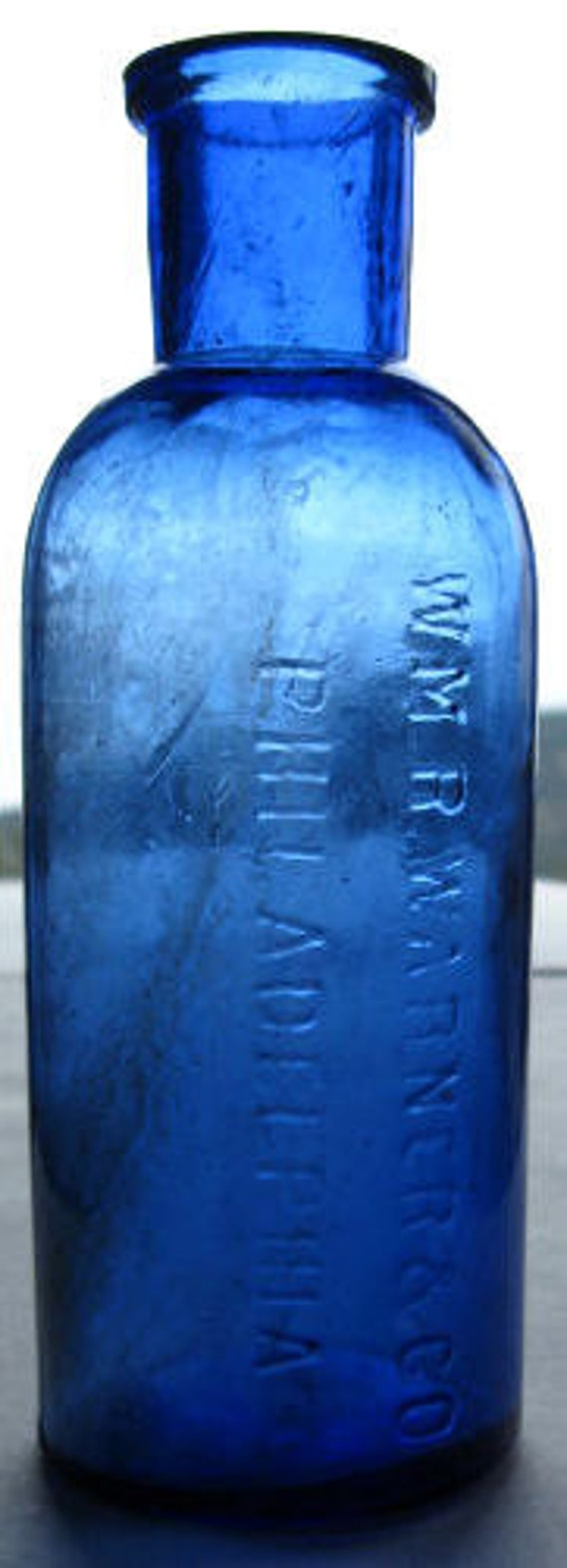 Original antique Wm WARNER quack medicine COBALT BLUE Cure bottle