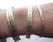 Vintage Faux gold bangles with cool pattern