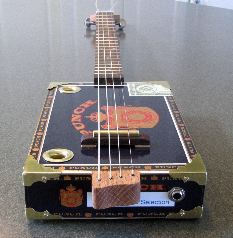 cigar box guitar 4 string black punch. Black Bedroom Furniture Sets. Home Design Ideas