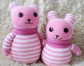 A pair of handmade sock bears-- mom and kid
