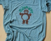 Bunnybear t shirt, brown with green flower halo on green t