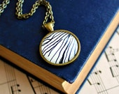 Woodgrain necklace made with vintage sheet music illustration.  Antiqued bronze pendant with domed glass.