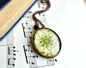 Geometric flower necklace made with vintage sheet music graphic.   Antiqued copper pendant and chain.