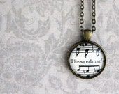 Sandman necklace. Antiqued bronze pendant with real vintage sheet music under glass dome.
