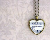 Sheet music necklace.  Antiqued bronze pendant with real vintage sheet music under glass dome.  In that dreamland