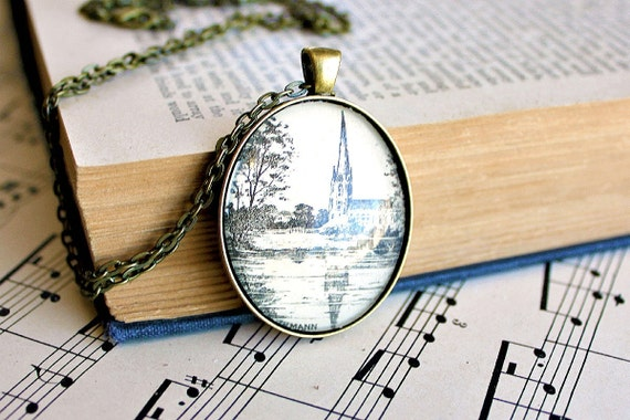 Church scene necklace made with vintage sheet music illustration.   Antiqued bronze pendant and chain.