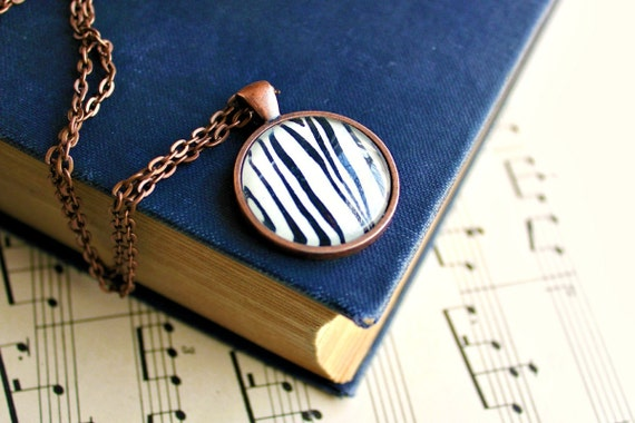 Woodgrain necklace made with vintage sheet music illustration.  Antiqued copper pendant with domed glass.