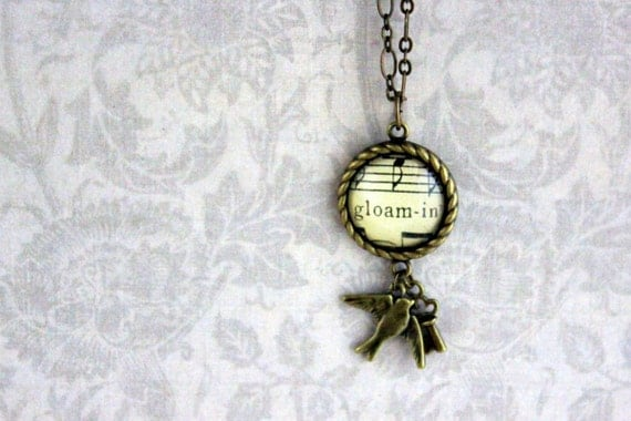 Charm sheet music necklace.  Antiqued bronze pendant with real vintage sheet music under glass.  Gloaming