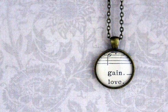 Sheet music necklace.  Antiqued bronze pendant with real vintage sheet music under glass dome.  gain love