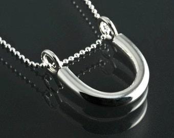 U shaped silver pendant