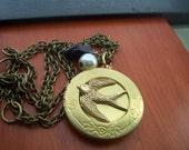 Hunger Games Necklace - Peeta's locket  with  Mockingjay -pearl and coal