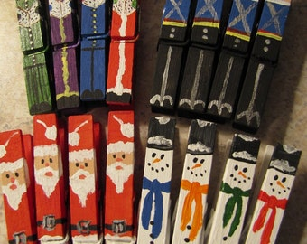 Set of 16 hand painted Christmas Clothespins Santas Snowmen Carolers Nutcrackers