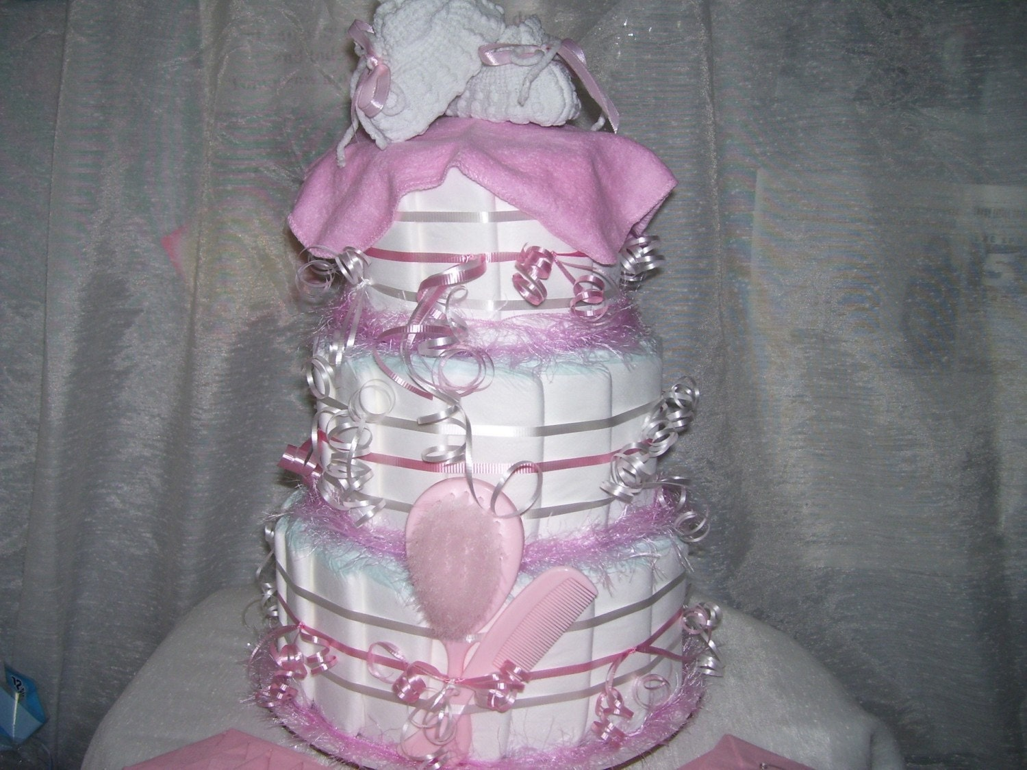 Precious pink diaper cake baby shower girl party favors table for Baby diaper decoration ideas