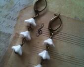 White Wisteria earrings, antiqued brass earwires, garnet swarovski crystal centre