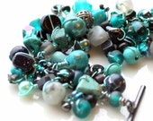 fringe bracelet. black and teal beads. assorted turquoise. can personalize with your fav charm- wire wrapped bracelet