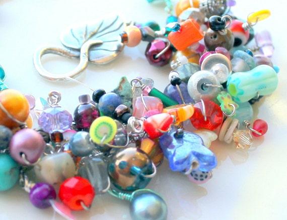 hamsa charm bracelet. beaded fringe colorful bracelet. wire wrapped beads silver leaf clasp fruit beads wire wrapped uniquenecks bracelet