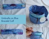 Umbrella on blue Fabric Cuff Bracelet