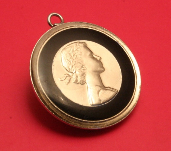 Vintage British coin pendant.  2 shilling coin with black enamel