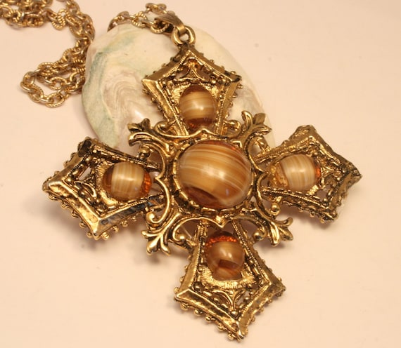Vintage Celtic style cross pendant. Agate style brown and cream glass pendant