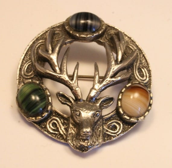 Vintage stag's head brooch with glass Scottish agate stones. Celitc