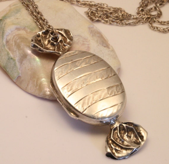 Vintage sweetie candy  locket.  Sterling silver