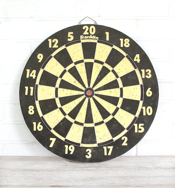 vintage yellow and black dart board