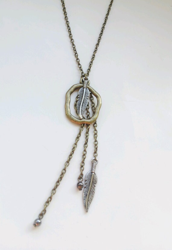 Tribal feather necklace:  mixed metal silver and brass