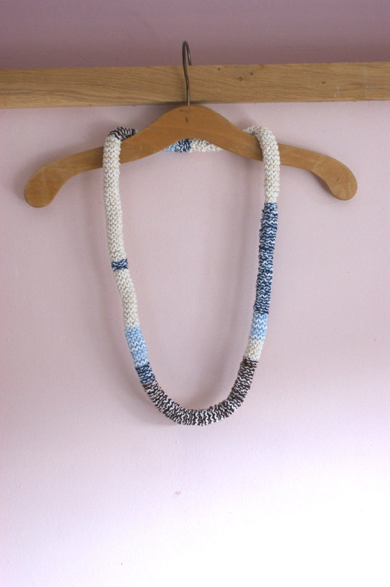 Knitted cotton necklace in blue denim, sand and brown