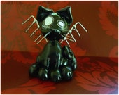 Cute strange Undead Kitty handmade from polymer clay with metal wings