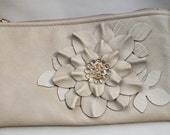 Leather wristlet, ivory flower and leaves with glass beaded center