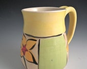 Green/yellow flower mug