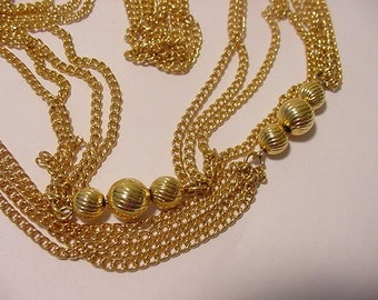 Vintage Gold Tone Metal Bead Four Strand Necklace  12  - 117