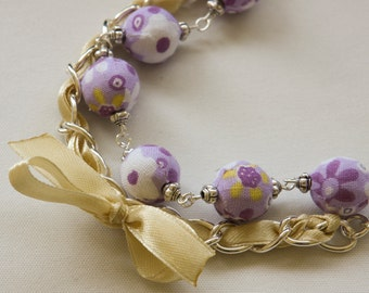Violet floral beads and yellow ribbon bracelet