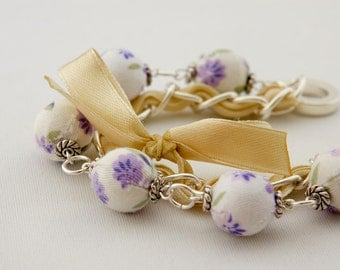 Violet flowers and yellow ribbon bracelet