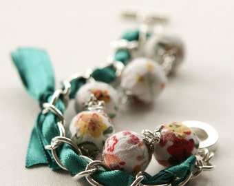 Emerald satin ribbon and floral fabric beads bracelet