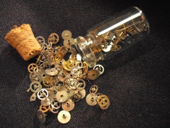 Glass Vial Filled With Teenie Tiny Watch Gears And Parts
