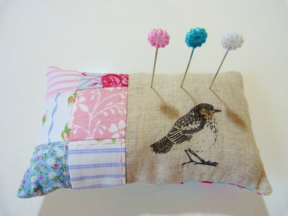 Pin cushion in pink and blue patchwork with linen in a bird theme