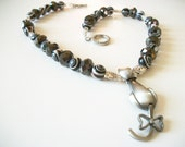 Beautiful Cat Necklace with Shiny Black and Swirl Design Beads