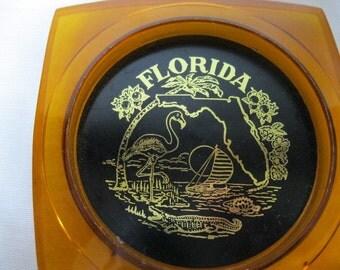 Vintage Florida Coasters Set of 4 Amber Black Plastic Collectible Souvenir