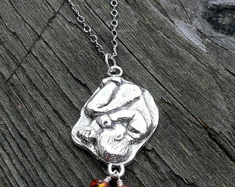In The Womb.  A Solid Sterling Pregnancy Necklace.